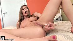 Bethsabe fingers her slick slit and sticks a glass dildo up her butt