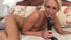 Horny blonde Ashley plays with a big dildo before having hardcore fun with a black rod