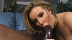 Buxom blonde milf blows a huge black dick before taking it deep in her tight peach