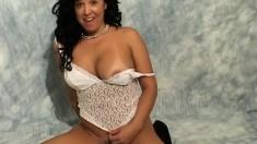 Bodacious Asian milf in black stockings Taeko gets on top of a dildo