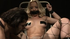 Tied up blonde slave is tortured and they use her as a fuck doll