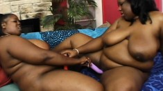 Curvy black milfs use tongues, fingers and toys to make each other cum