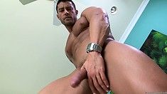 He sits and stands as he pleasures his rigid rod in his bedroom