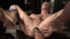 Muscled hunk gets his cock sucked and his ass fist fucked by his buddy