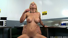Blonde with shapely fake tits fucks herself by riding a dick