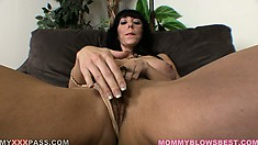 Huge tit Milf brunette strips down to show her big knockers and fingers twat