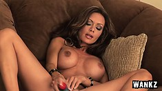 Alluring stacked brunette with sexy legs Crissy feeds her hungry pussy a big sex toy