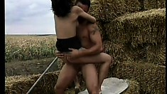 Raunchy brunette farm girl takes the proverbial roll in the hay