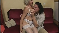 Naughty granny gets her huge saggy tits fucked by a young hunk
