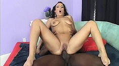 Striking brunette with big tits and a superb ass bounces on a black rod with fervor