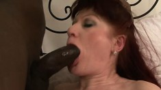 Horny mature Esmeralda getting pounded by a hung black guy on the bed