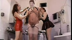 Horny male sex slave submits to the will of his slutty Mistresses