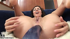 Brunette cutie, Monica B., uses a big anal dildo to stretch her ass
