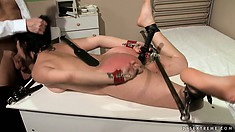 She's tied up and gagged and gets her ass whacked before she blows