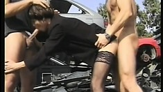 A short haired chick shows off her sexy talents as she takes two cocks