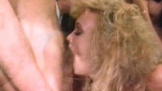 Curly haired slut gets her freak on in this hardcore vintage video