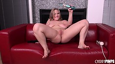 Vicky leans over to toy and lies back down on the couch for deep toying