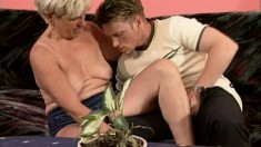 Short haired blonde granny can't resist a young guy with a big stick