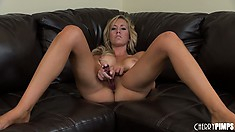 Naughty blonde tart holds her pussy lips wide open after she cums