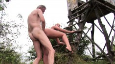 Cute young brunette gets fucked deep by the horny old ranger outside