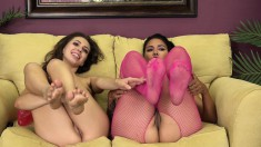 Enticing babes get together on the couch for a torrid lesbian romance