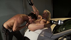 The stacked blonde has him licking her twat and returns the favor with a deep blowjob
