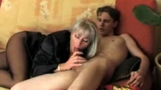 Horny amateur Mature woman rides young cock on the bed