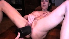 Sexy Brunette Fisting And Toying Both Holes