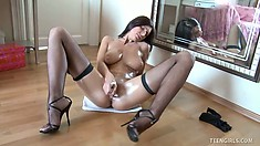 Sexy brunette supermodel Tessa teases her wet twat with a cold glass dildo