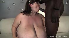 Fat brunette has some massive tits and she sucks on black cock