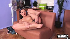 Kailey spreads 'em wide and throws them up as she diddles her cunt