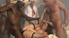 Busty brunette gets all her holes ravaged by the devils gangbang