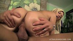 Skinny blonde babe gets her freak on with a big dick on the couch
