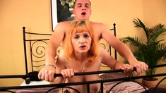 Redhead mature fucks young guy in the open air