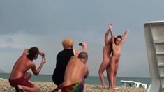 Voyeur on public beach. Girls posing