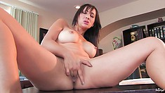 Busty brunette is in her study and gets naked to go for some orgasmic fun